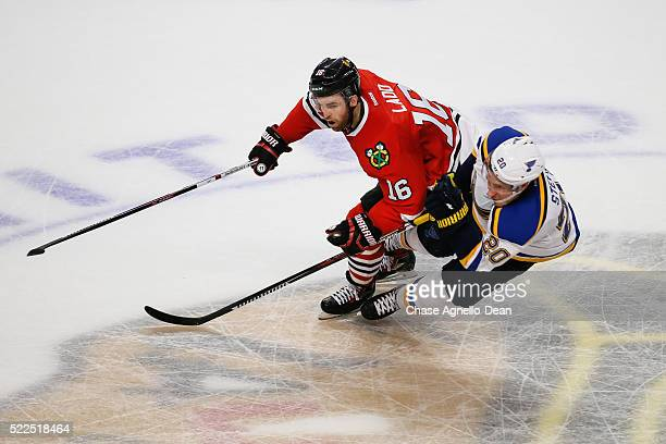 Andrew Ladd of the Chicago Blackhawks and Alexander Steen of the St Louis Blues skate in the second period of Game Four of the Western Conference...