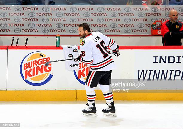 Andrew Ladd of the Chicago Blackhawks bounces a puck on his stick during the pregame warm up prior to NHL action against the Winnipeg Jets at the MTS...