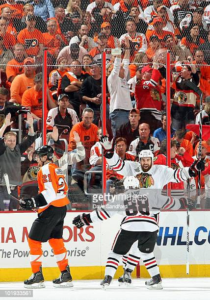 Andrew Ladd of the Chicago Blackhawks celebrates his second period goal with teammate Patrick Kane against the Philadelphia Flyers during Game Six of...