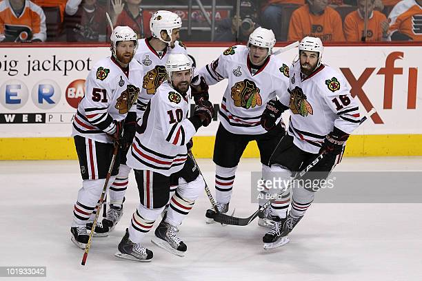 Andrew Ladd of the Chicago Blackhawks celebrates with teammates after scoring a goal in the second period against the Philadelphia Flyers in Game Six...