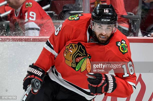 Andrew Ladd of the Chicago Blackhawks watches the puck fly by in the first period of the NHL game against the Minnesota Wild at the United Center on...
