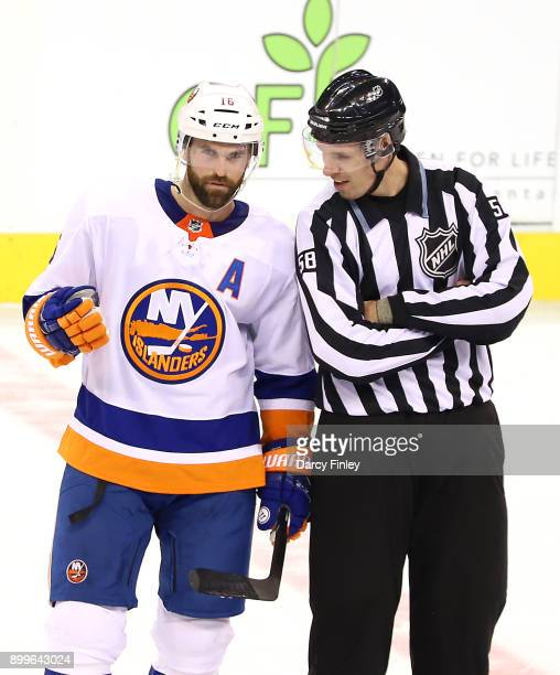 Andrew Ladd of the New York Islanders chats with linesman Ryan Gibbons during a first period stoppage in play against the Winnipeg Jets at the Bell...