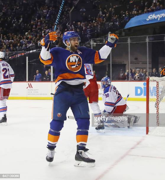 Andrew Ladd of the New York Islanders scores at 624 of the second period against Henrik Lundqvist of the New York Rangers at the Barclays Center on...