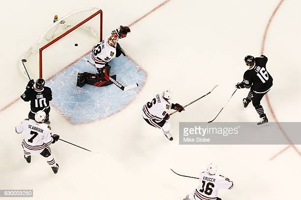Andrew Ladd of the New York Islanders shots the puck past Scott Darling of the Chicago Blackhawks for a first period goal at the Barclays Center on...