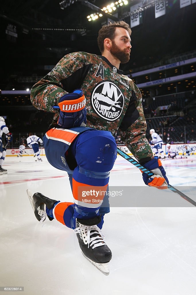 check out 8a2bd 55c25 Andrew Ladd of the New York Islanders sports a camo warm up ...