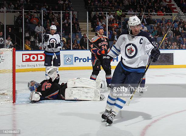 Andrew Ladd of the Winnipeg Jets celebrates his first period goal against the New York Islanders at the Nassau Veterans Memorial Coliseum on April 5...