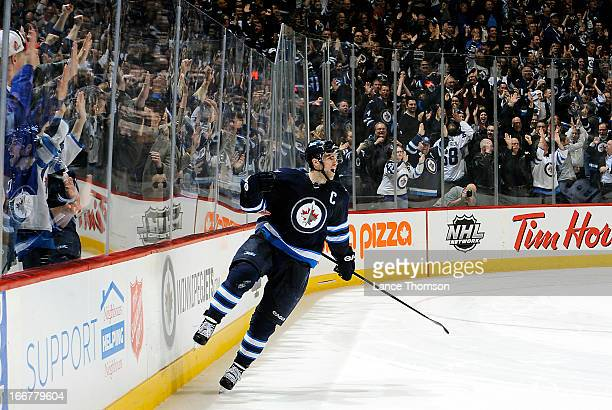 Andrew Ladd of the Winnipeg Jets celebrates his winning shootout goal against the Tampa Bay Lightning in front of fans at the MTS Centre on April 16...