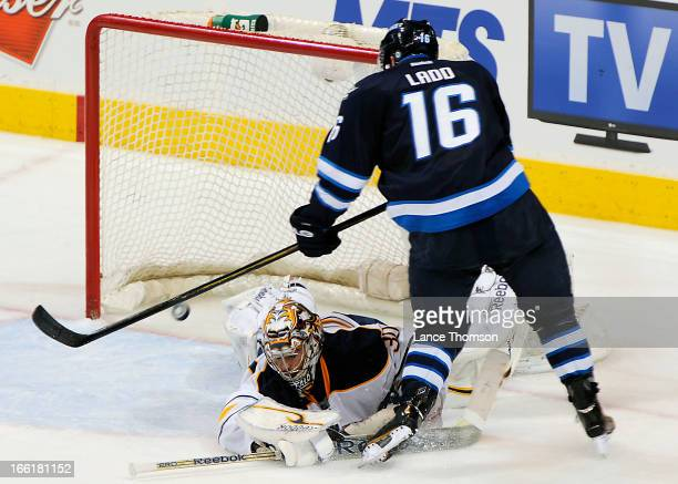 Andrew Ladd of the Winnipeg Jets dekes out goaltender Ryan Miller of the Buffalo Sabres for a second period goal at the MTS Centre on April 9 2013 in...