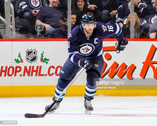 Andrew Ladd of the Winnipeg Jets follows the play down the ice during first period action against the Boston Bruins on December 19 2014 at the MTS...