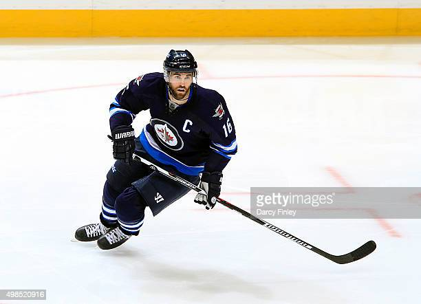 Andrew Ladd of the Winnipeg Jets follows the play up the ice during third period action against the Colorado Avalanche at the MTS Centre on November...