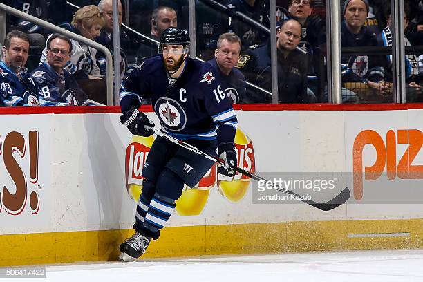 Andrew Ladd of the Winnipeg Jets follows the play up the ice during third period action against the Colorado Avalanche at the MTS Centre on January...