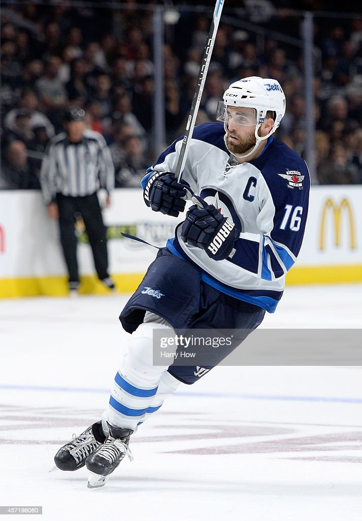 Andrew Ladd #16 of the Winnipeg Jets forechecks during a 4-1 loss to the Los Angeles Kings at Staples Center on October 12, 2014 in Los Angeles, California.