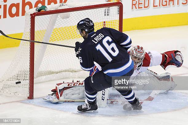 Andrew Ladd of the Winnipeg Jets misses a chance at a goal as Carey Price of the Montreal Canadiens guards his net in third period action of an NHL...