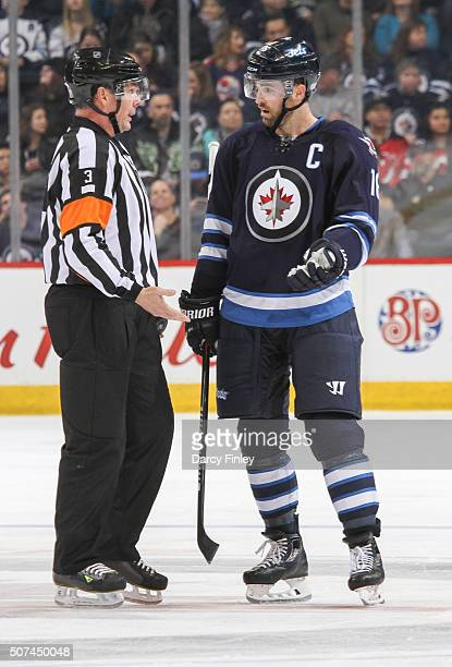 Andrew Ladd of the Winnipeg Jets questions referee Mike Leggo during a third period stoppage in play against the New Jersey Devils at the MTS Centre...