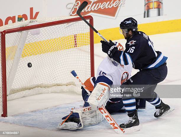 Andrew Ladd of the Winnipeg Jets scores a goal against Anders Nilsson of the New York Islanders in third period action in an NHL game at the MTS...