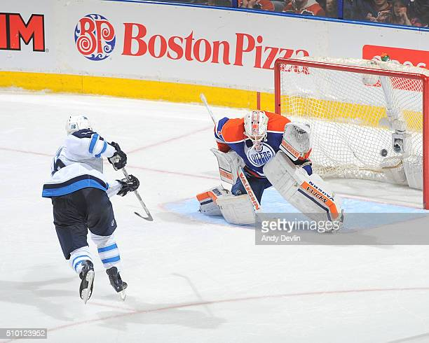 Andrew Ladd of the Winnipeg Jets scores a shootout goal on Laurent Brossoit of Edmonton Oilers on February 13 2016 at Rexall Place in Edmonton...