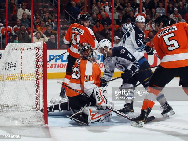 Andrew Ladd of the Winnipeg Jets scores the game winning goal against Ilya Bryzgalov of the Philadelphia Flyers at 1854 of the third period at the...