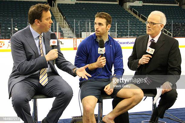 Andrew Ladd of the Winnipeg Jets takes part in CBC's Hockey Night in Canada After Hours segment with hosts Elliotte Friedman and Scott Oake following...