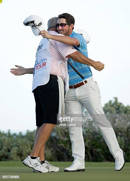 Andrew Landry and his caddie Terry Walker share a hug after putting out on the 18th hole during the final found of The Bahamas Great Abaco Classic at...