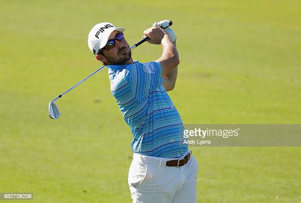 Andrew Landry hits his second shot on the 12th hole during the final found of The Bahamas Great Abaco Classic at the Abaco Club on January 25 2017 in...