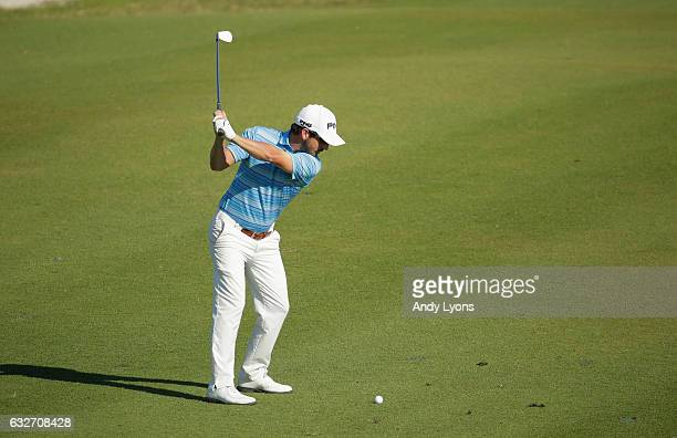 Andrew Landry hits his second shot on the 14th hole during the final found of The Bahamas Great Abaco Classic at the Abaco Club on January 25 2017 in...