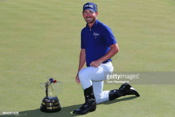 Andrew Landry holds the Valero Texas Open trophy for a photo after the final round of the Valero Texas Open at TPC San Antonio ATT Oaks Course on...