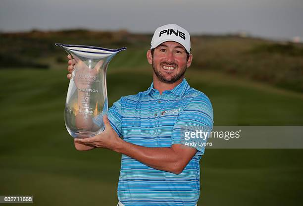 Andrew Landry holds the winner's trophy after winning The Bahamas Great Abaco Classic at the Abaco Club on January 25 2017 in Great Abaco Bahamas