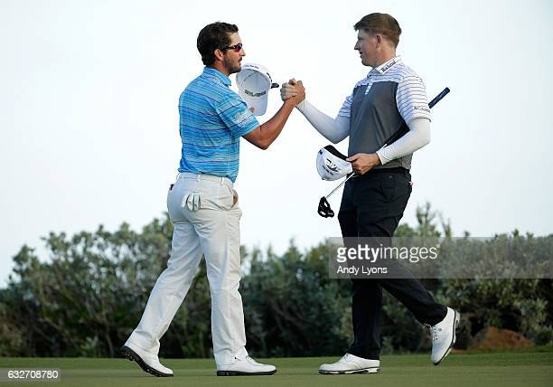 Andrew Landry is greeted by Martin Piller after putting out on the 18th hole during the final found of The Bahamas Great Abaco Classic at the Abaco...