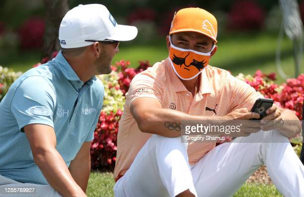 Andrew Landry of the United States and Rickie Fowler of the United States wait to watch the finish near the 18th green during the final round of the...
