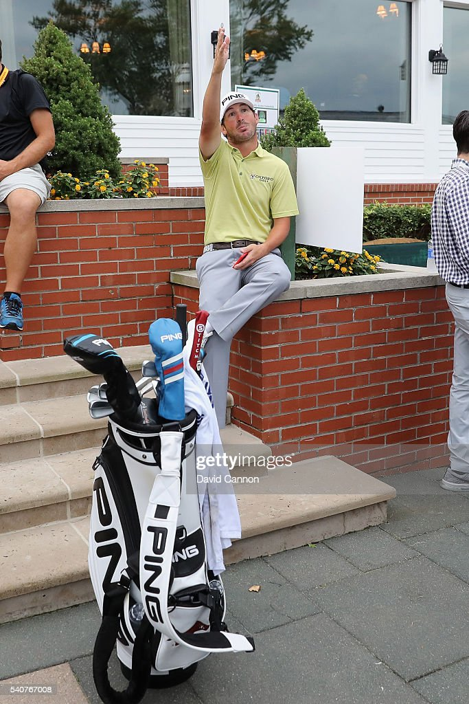 Andrew Landry of the United States sits near the clubhouse after play was suspended by dangerous weather during the first round of the U.S. Open at Oakmont Country Club on June 16, 2016 in Oakmont, Pennsylvania.