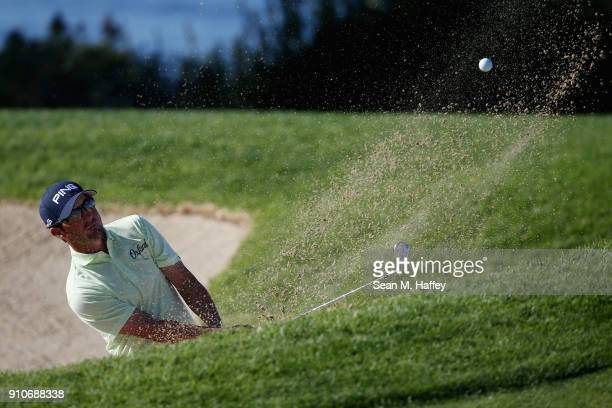 Andrew Landry plays a shot from a bunker on the fourth hole during the second round of the Farmers Insurance Open at Torrey Pines South on January 26...