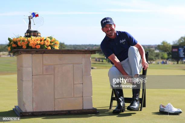 Andrew Landry puts on the Champion's Boots after winning the Valero Texas Open at TPC San Antonio ATT Oaks Course on April 22 2018 in San Antonio...