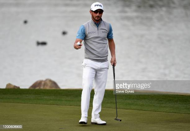Andrew Landry reacts after putting in to win on the 18th green during the final round of The American Express tournament at the Stadium Course at PGA...