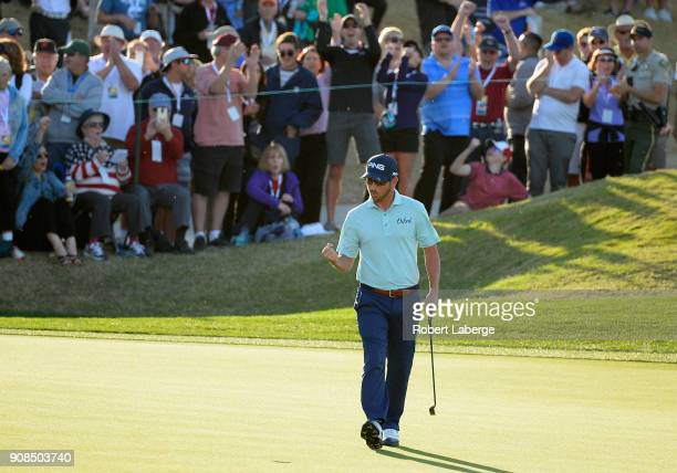 Andrew Landry reacts to his birdie putt to force a playoff on the 18th hole during the final round of the CareerBuilder Challenge at the TPC Stadium...