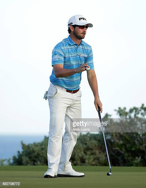 Andrew Landry waves to the crowd after putting out on the 18th hole during the final found of The Bahamas Great Abaco Classic at the Abaco Club on...