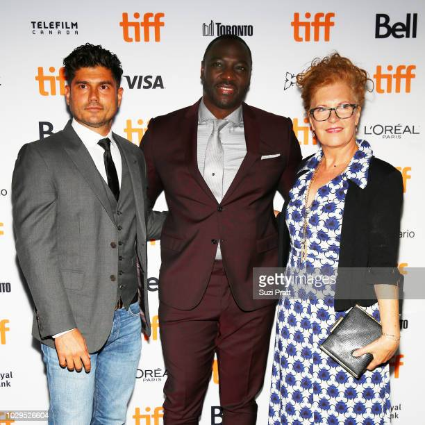 Andrew Levitas Adewale AkinnuoyeAgbaje and guest attend the 'Farming' premiere during 2018 Toronto International Film Festival at Scotiabank Theatre...