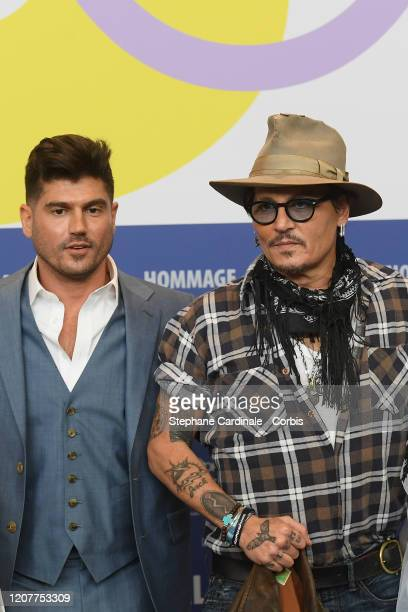 Andrew Levitas and Johnny Depp attend the Minamata press conference during the 70th Berlinale International Film Festival Berlin at Grand Hyatt Hotel...