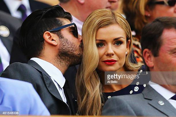 Andrew Levitas and Katherine Jenkins look on from the Royal Box on day eight of the Wimbledon Lawn Tennis Championships at the All England Lawn...