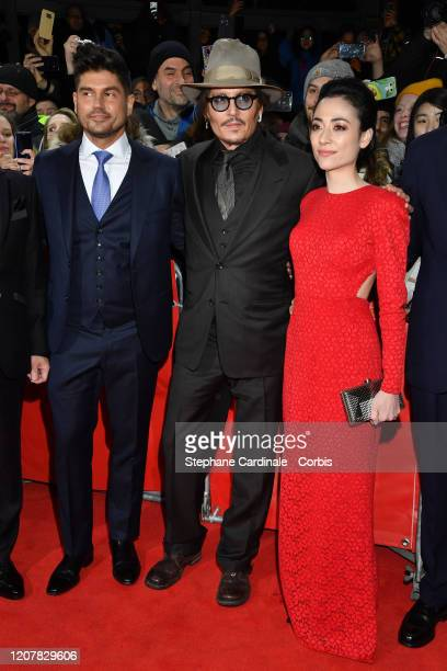 Andrew Levitas Johnny Depp and Minami pose at the Minamata premiere during the 70th Berlinale International Film Festival Berlin at...