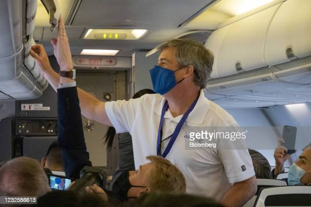 Andrew Levy, chief executive officer of Avelo Airlines, secures overhead compartments during the Avelo Airlines inaugural flight from Hollywood...
