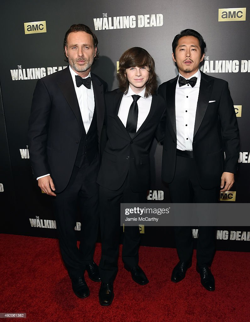Andrew Lincoln; Chandler Riggs and Steven Yeun attend AMC's 'The Walking Dead' Season 6 Fan Premiere Event 2015 at Madison Square Garden on October 9, 2015 in New York City.