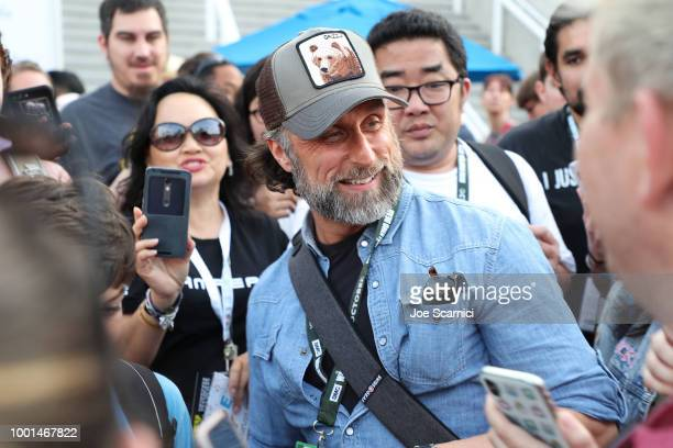 Andrew Lincoln cosplayer Cecil Grimes takes photos with fans outside the San Diego Convention Center on July 18 2018 in San Diego California