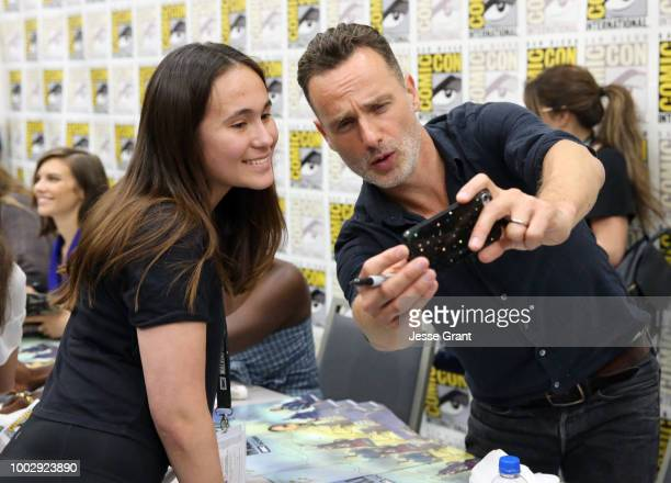 Andrew Lincoln takes a photo with a fan at 'The Walking Dead' autograph signing with AMC during during ComicCon International 2018 at San Diego...
