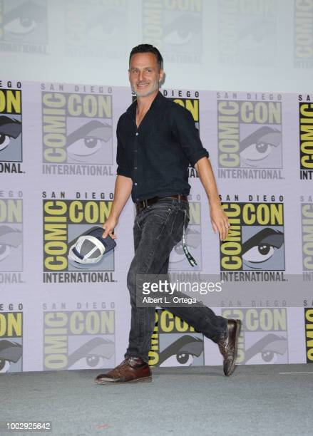 "Andrew Lincoln walks onstage at AMC's ""The Walking Dead"" panel during Comic-Con International 2018 at San Diego Convention Center on July 20, 2018 in..."