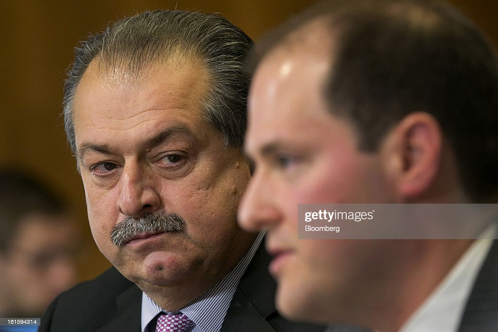 Andrew Liveris, chairman and chief executive officer of Dow Chemical Co., left, looks on as Ross Eisenberg, vice president of energy and resources policy at the National Association of Manufacturers, speaks during a Senate Energy and Natural Resources Committee hearing in Washington, D.C., U.S., on Tuesday, Feb. 12, 2013. The top two members of a Senate committee for energy split over expanding U.S. natural gas exports, mirroring a disagreement between fuel consumers such as Dow Chemical Co. and producers such as Exxon Mobil Corp. Photographer: Andrew Harrer/Bloomberg via Getty Images