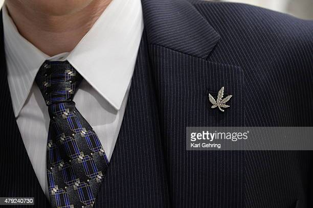 Andrew Livington sported a marijuana leaf lapel pin as he mingled before the Colorado Symphony Classically Cannabis private fundraising event at the...