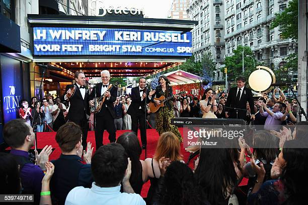 Andrew Lloyd Webber Steve Martin LinManuel Miranda Edie Brickell Sara Bareilles and Glenn Slater perform onstage during the 70th Annual Tony Awards...