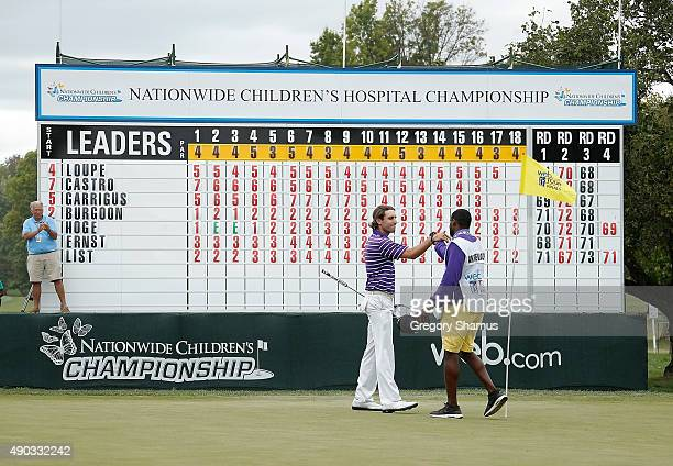 Andrew Loupe and his caddie Wayne Birch celebrate a final round 70 that turned out to win the Webcom Tour Nationwide Children's Hospital Championship...