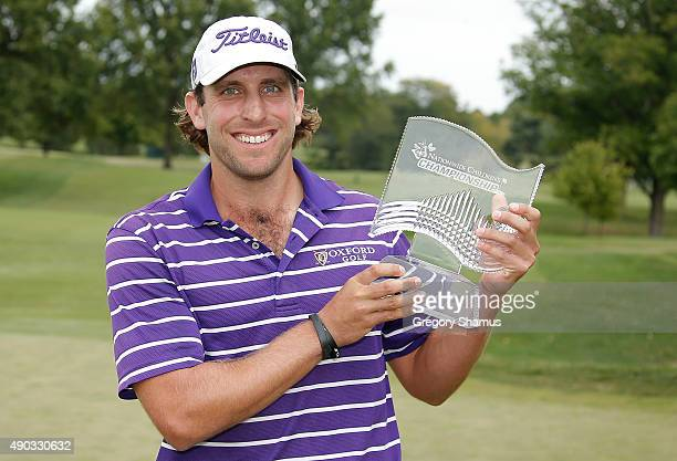Andrew Loupe holds the champions trophy after winning the Webcom Tour Nationwide Children's Hospital Championship at The Ohio State University Golf...