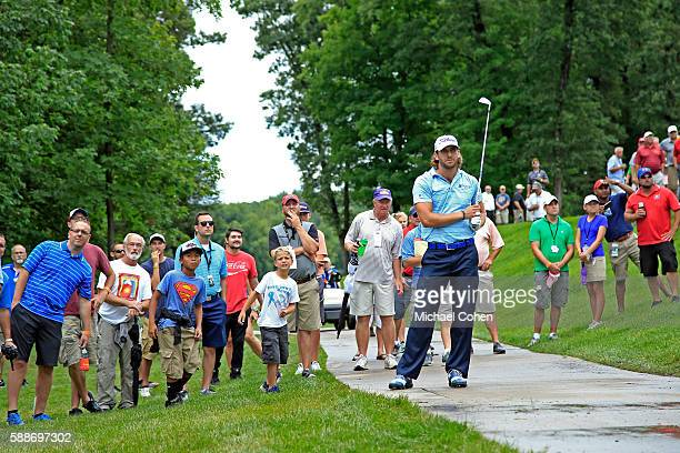 Andrew Loupe looks after his shot on the seventh hole during the continuation of the first round of the John Deere Classic at TPC Deere Run on August...